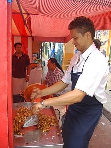 Vendor mixing candies