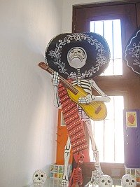 Dia del los Muertos art (Paper mache Skeleton guitar player)